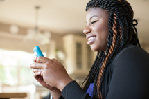 African-American woman checking her cellphone