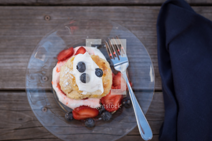 blueberries and strawberries an a pastry