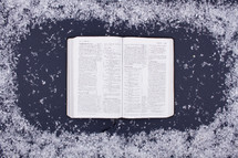 open Bible and snow border