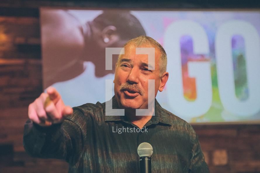 a man at a microphone giving a speech