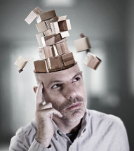 man lost in thought as his mind is filled with empty boxes.