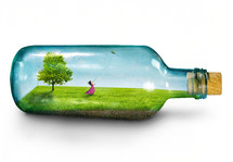a woman in a bottle flying a kite