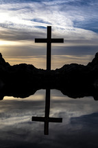 tide pool and silhouette of a cross