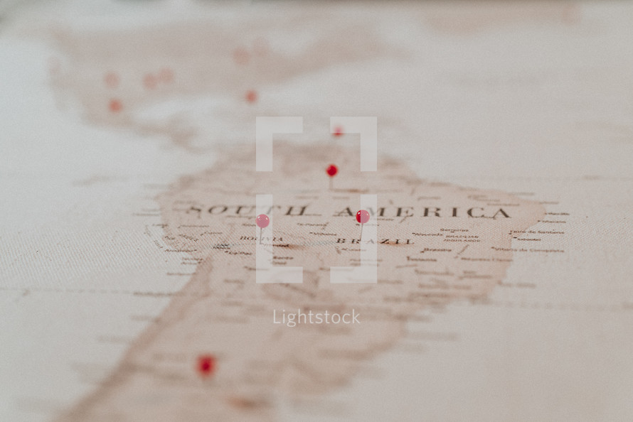 push-pins on a map of South America