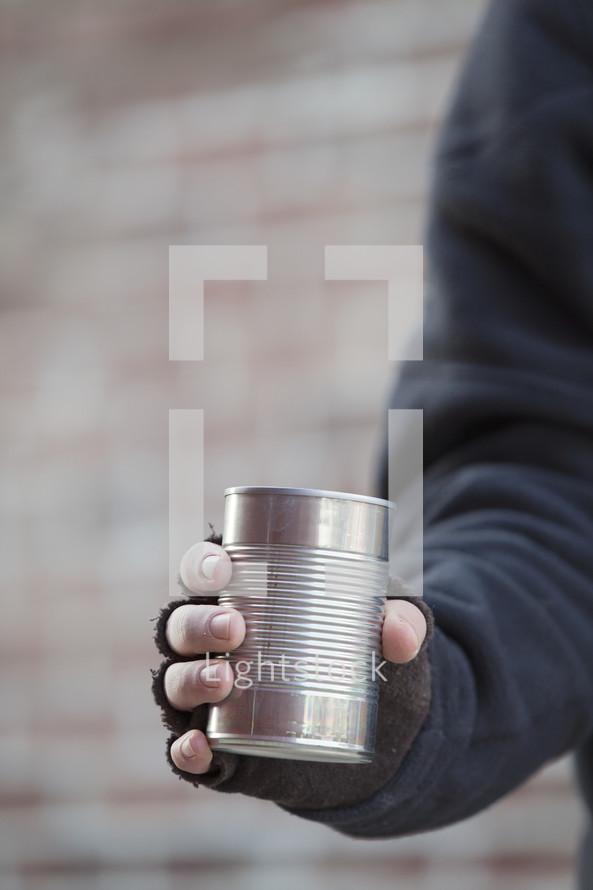 beggar with tin can