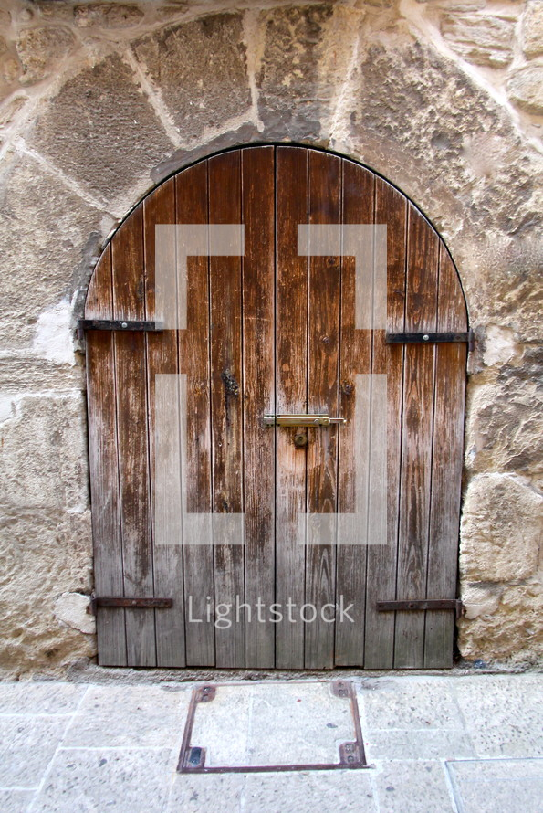A wooden door to an ancient cathedral
