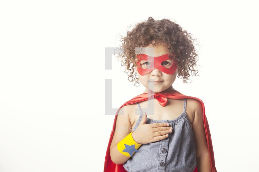 Child dressed up like a superhero.