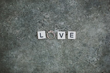 word love - scrabble pieces and an engagement ring