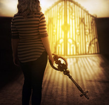 A woman holding the key to Heaven