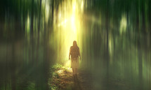 a woman with a backpack standing in a glowing forest
