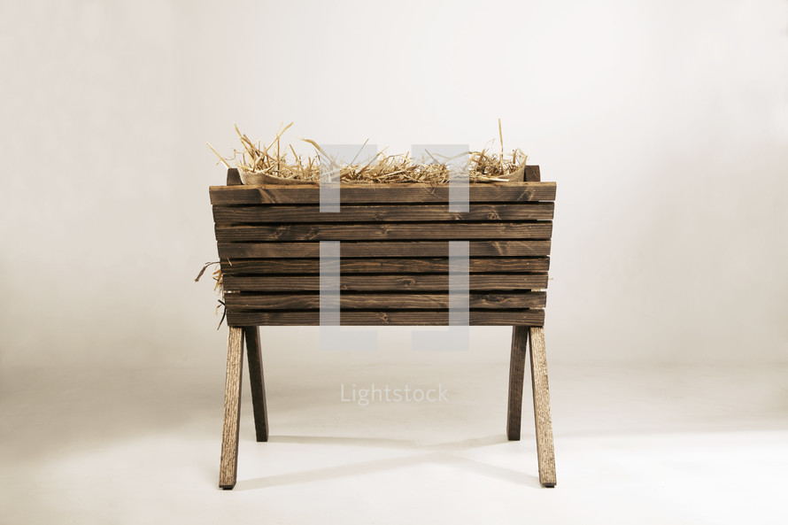 wooden manger with hay.