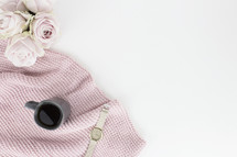 pink flowers, vase, coffee, pink scarf, watch, white background