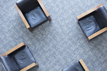 Aerial view of four chairs on carpet.