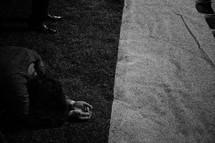 kneeling in prayer in grass