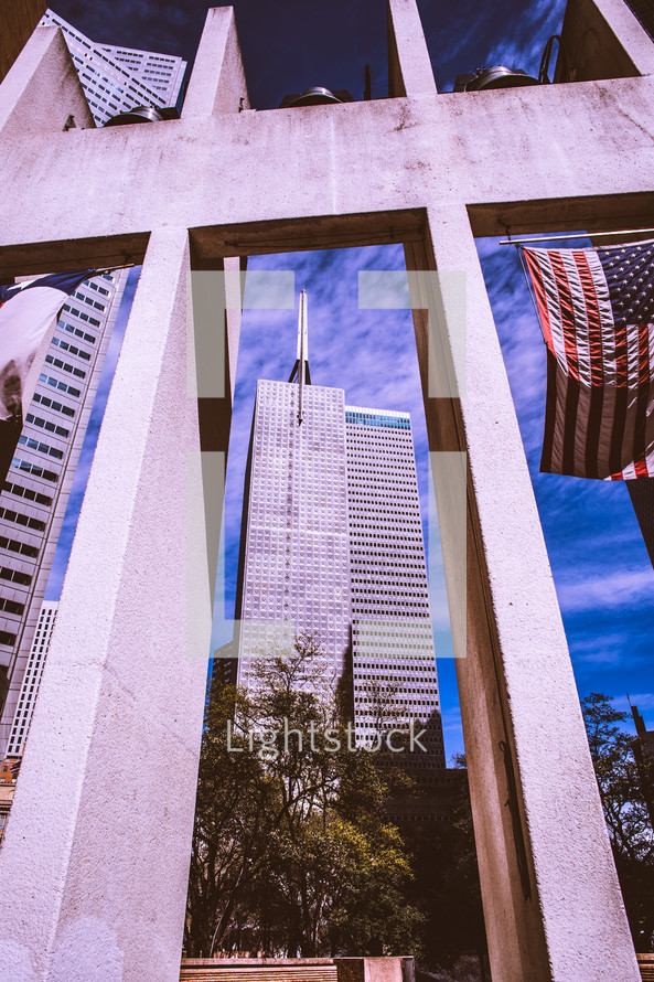 view of city buildings and an American flag