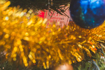 tinsel and ornaments on a Christmas tree