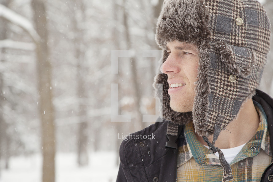 Man in a winter hat outdoors.