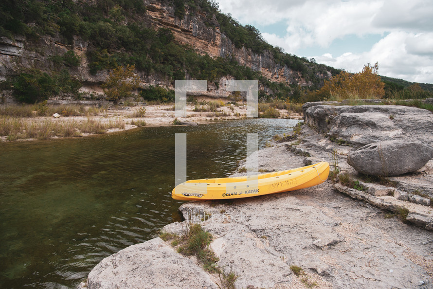 kayak on the edge of a river