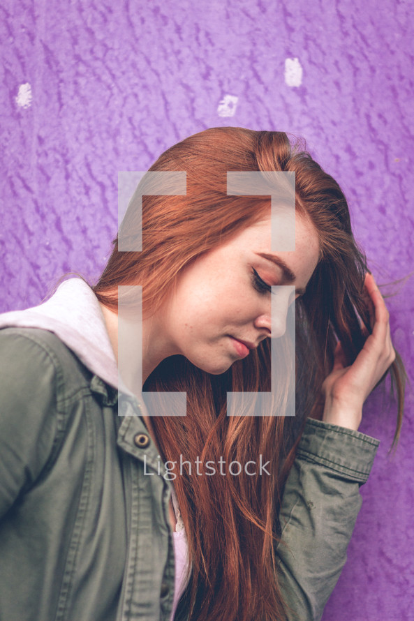 side profile of a redhead young woman