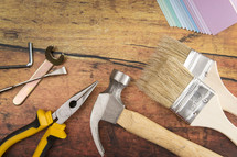 Tools and Needed Things for Home Improvement on a Wooden Table