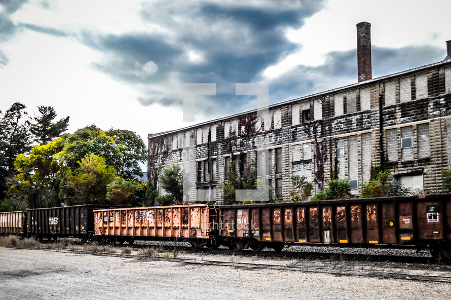 old warehouse and parked train cars