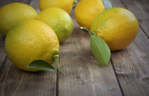 Lemons on a wood board table.