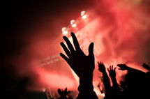 Hands raised at worship concert