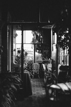 An empty chair in a quiet café. Black-and-white.