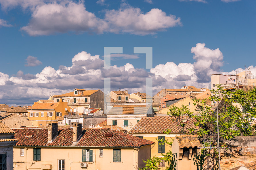 tile roof houses under a blue sky