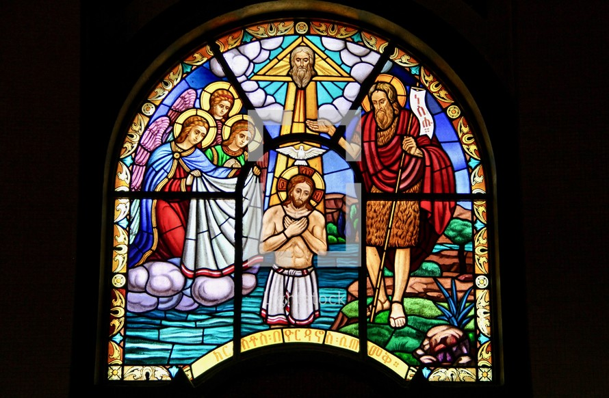 Stained glass window of the Baptism of Jesus by John the Baptist