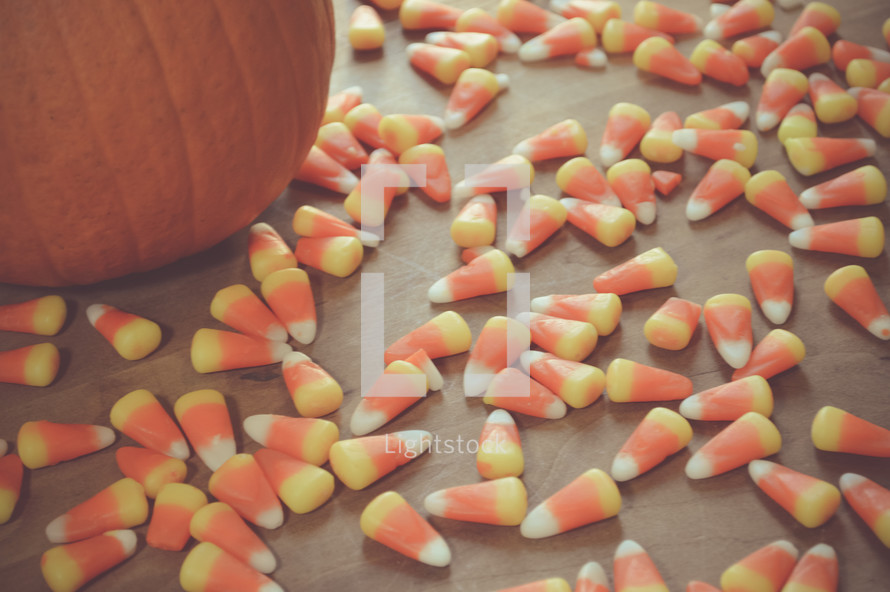 orange pumpkin and candy corn