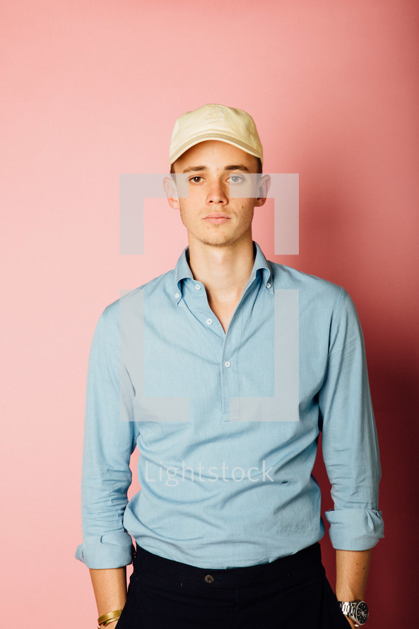 portrait of a young man in a ball cap