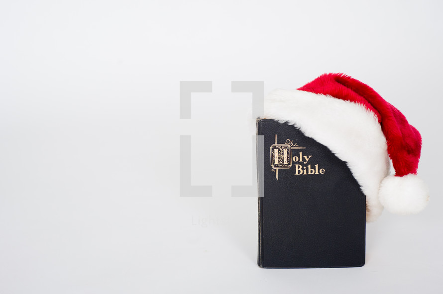 Santa hat and Holy Bible