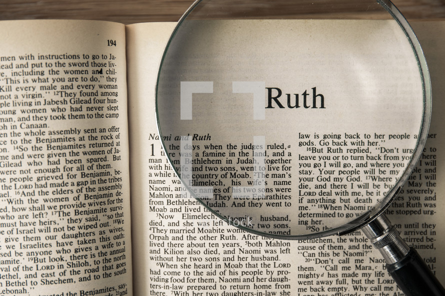 magnifying glass over Bible - Ruth