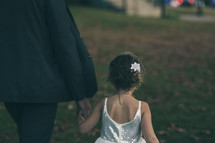 father walking with his daughter