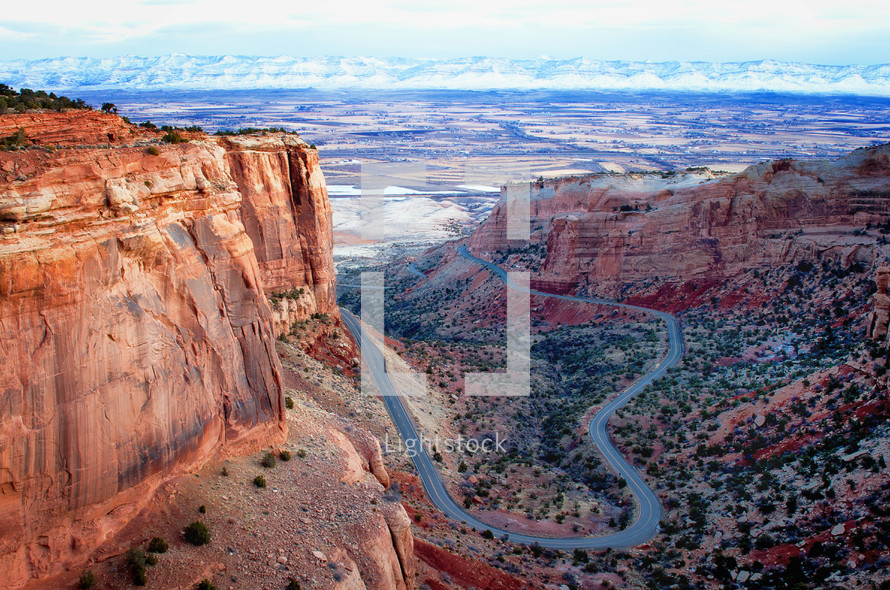 The road winds up to the Colorado National Monument outside of the Colorado National Monument