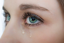 tears in a woman's eyes