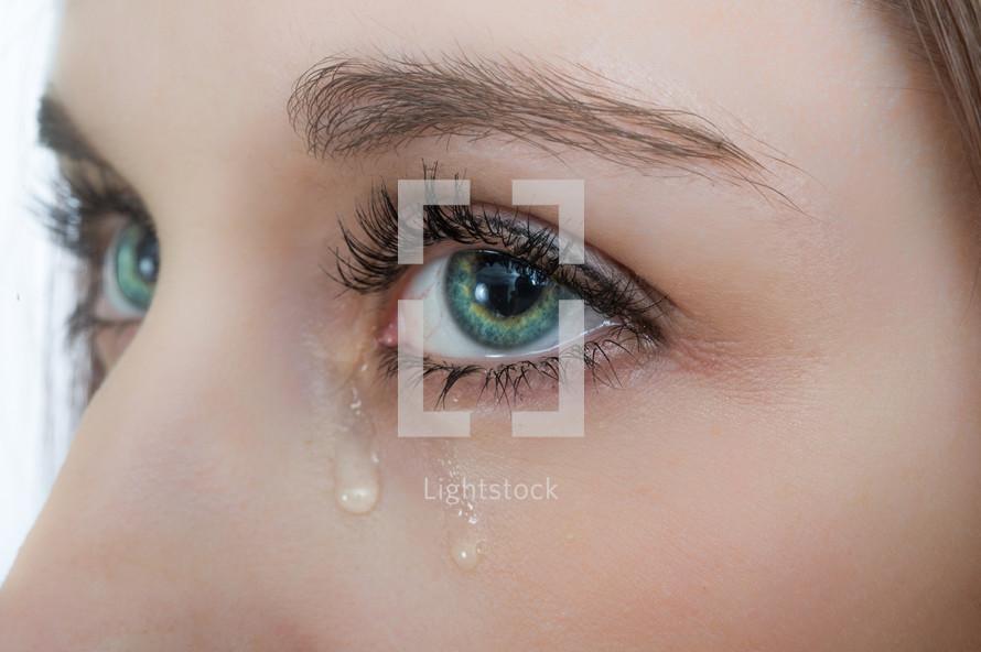 tears in a woman's eyes