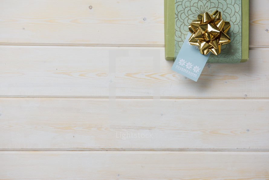 Christmas gift on wood boards