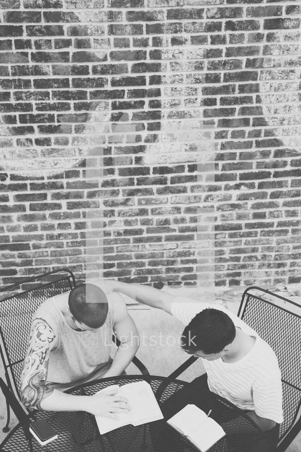 men reading Bible at a Bible study