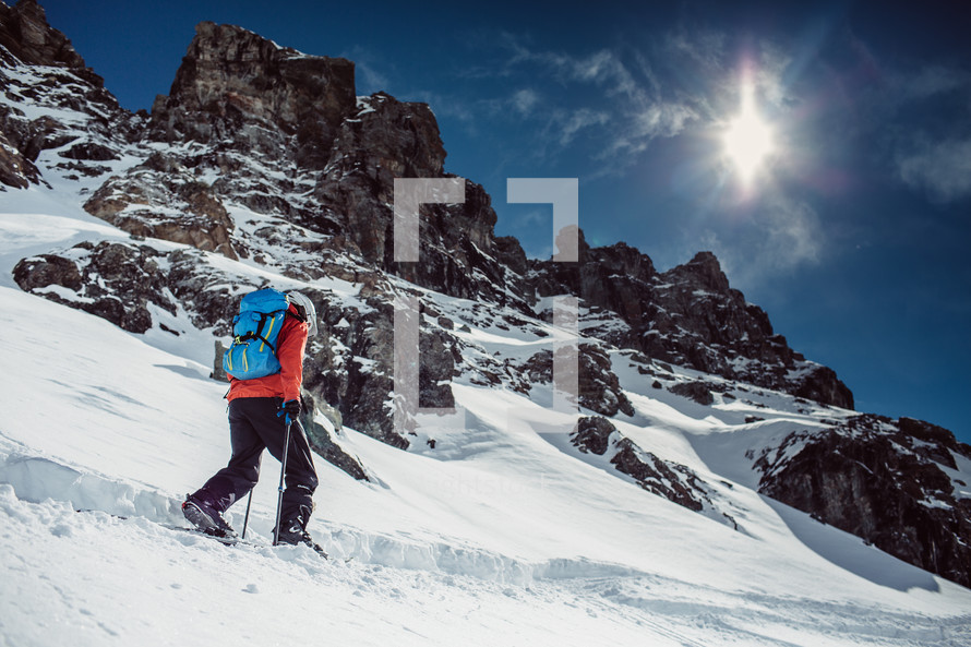 hiking up a snow cover mountainside