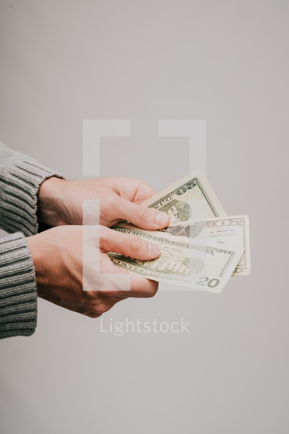 a man holding out cash