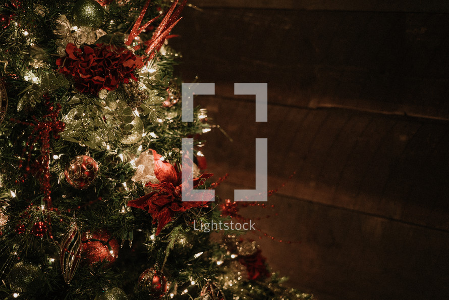 decorated Christmas tree and wood cabin wall