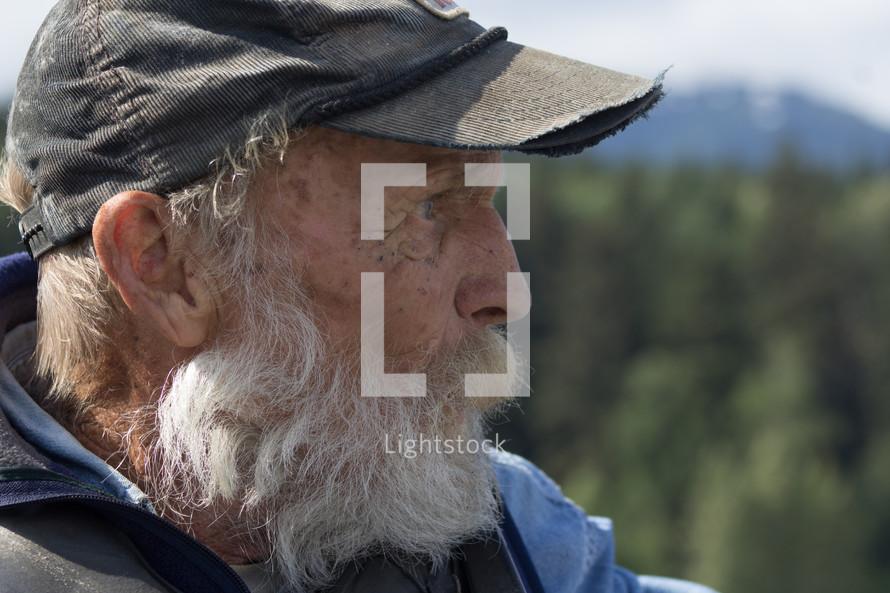 an elderly man with a white beard