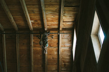 rope tied to ceiling beams