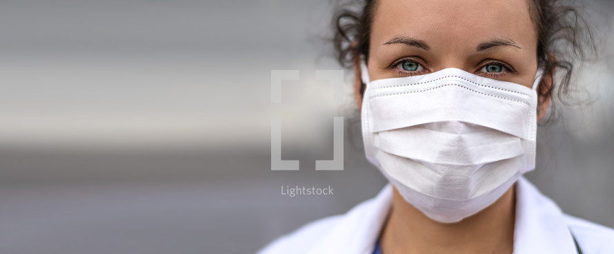 female doctor in a surgical mask