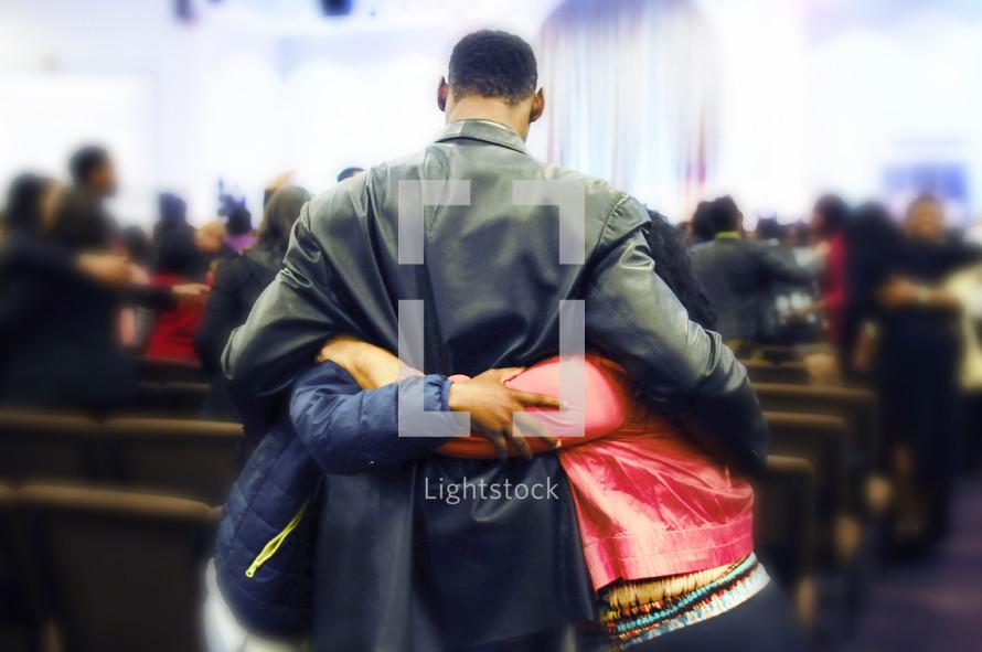 hugs of friendship in a church