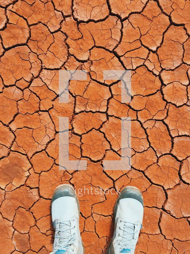 man standing on parched earth