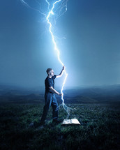 man holding a lightning strike over a Bible