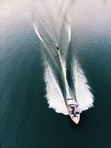 wake of a motor boat with a water skier being pulled behind